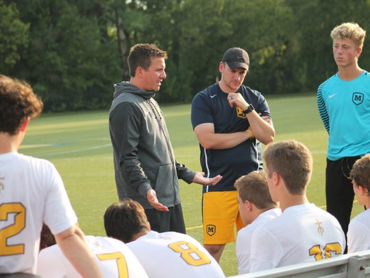 Moeller coach Mike Welker talks to the Crusaders at halftime Aug. 29.