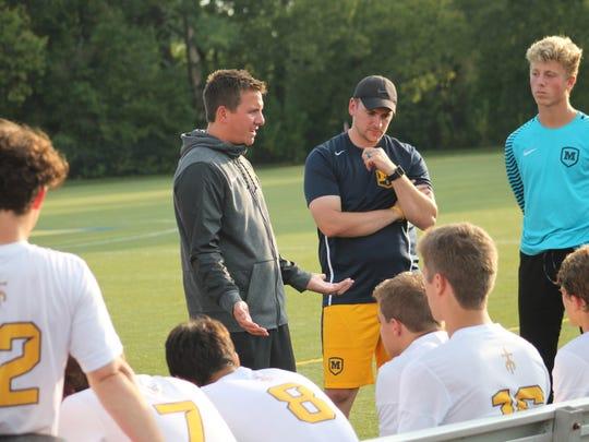 Moeller coach Mike Welker talks to the Crusaders at