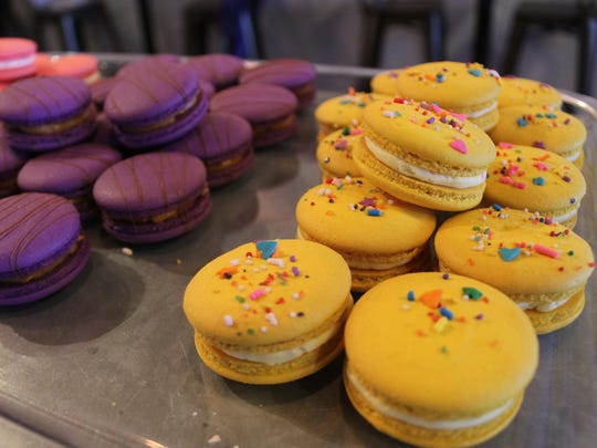 Samoa macarons (from left) and birthday cake macarons from Moonlight Macarons are sold at 8te on Airline Road.