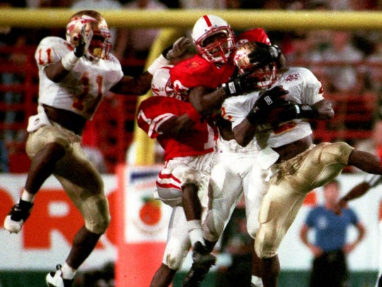 Clifton Abraham intercepts a pass against Nebraska in the 1994 Orange Bowl. Devin Bush (11) is also seen in this file photo.