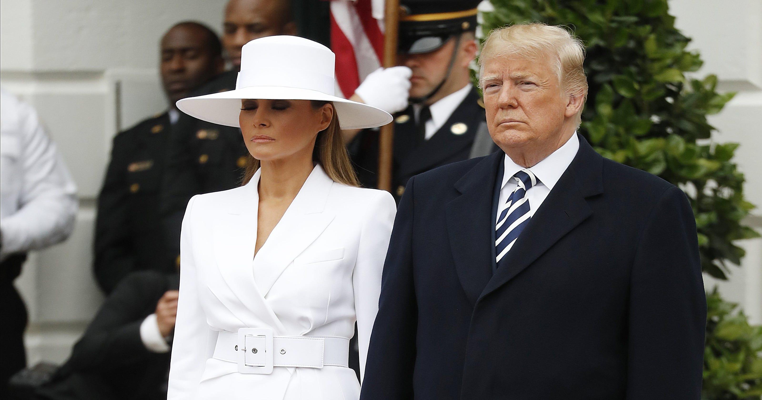 337b2f1005a Melania s white hat and suit gain Beyoncé