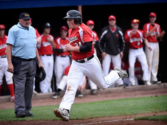 Annville-Cleona's Ben Miller races down the third base