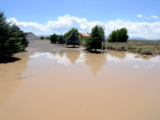 Flood waters recede in front of 1985 Fremont St. in Douglas County Monday July 21, 2014 afer a flash flood hit the area Sunday evening.