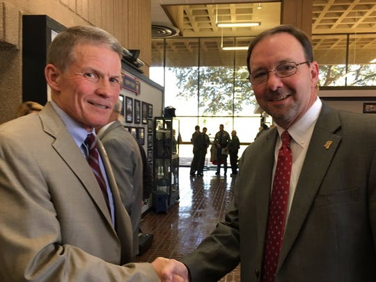 Marshall Fisher, left, and Mississippi Bureau of Narcotics Director John Dowdy shake hands in this file photo.