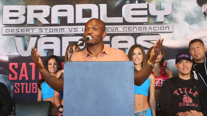 Timothy Bradley Jr. speaks during his presser with opponent Jessie Vargas, at right, during their last press conference prior to their bout at Stubhub Center in Carson, California on Saturday June 27, 2015.