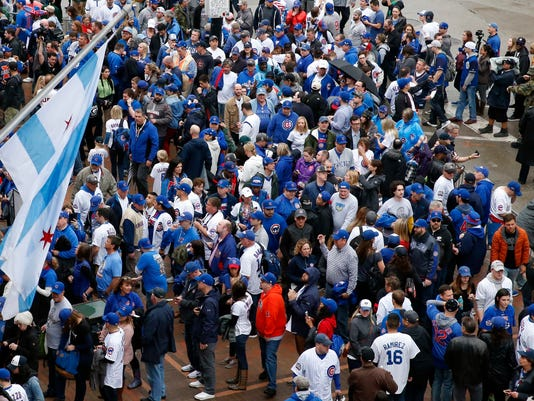 Fans line up outside Wrigley Field before a baseball game between the Chicago Cubs and the Los Angeles Dodgers on home opening day, Monday, April 10, 2017, in Chicago. (AP Photo/Nam Y. Huh)