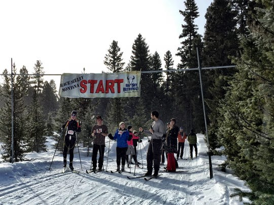 Racers wait at the starting line for the Seeley Lake Challenge Biathlon to begin.