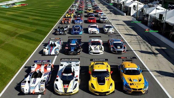 The 53 entries for this weekend's Rolex 24 At Daytona line up in pit lane at Daytona International Speedway.