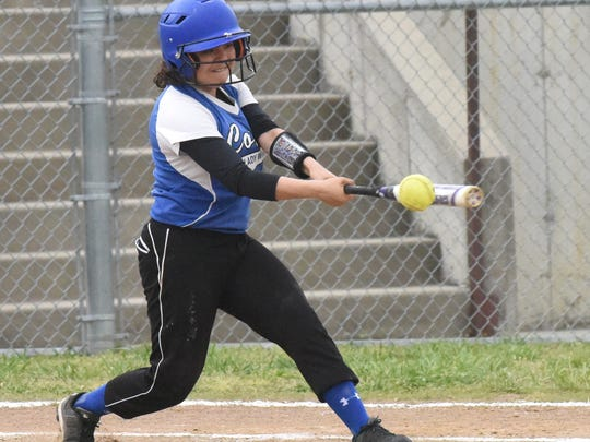 Cotter's Hannia Garay swings at a pitch during a game