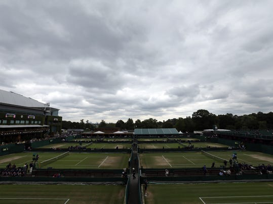 Dark clouds above the All England Club on day eight at the Wimbledon Tennis Championships in London Tuesday, July 11, 2017. (AP Photo/Tim Ireland)