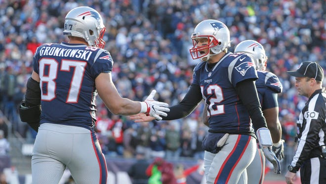 Patriots tight end Rob Gronkowski, left, celebrates his touchdown against the Miami Dolphins with quarterback Tom Brady. Both are top-five fantasy picks at their positions in Week 13.