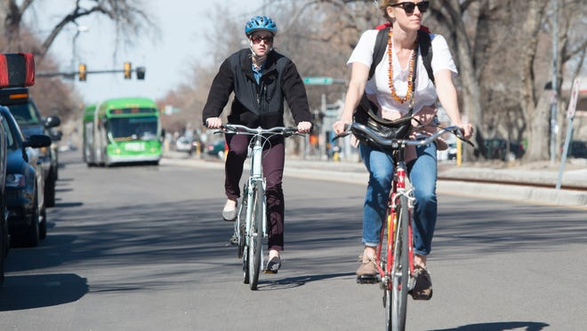 Cyclists travel southbound on Mason Street Friday, March 11, 2016.