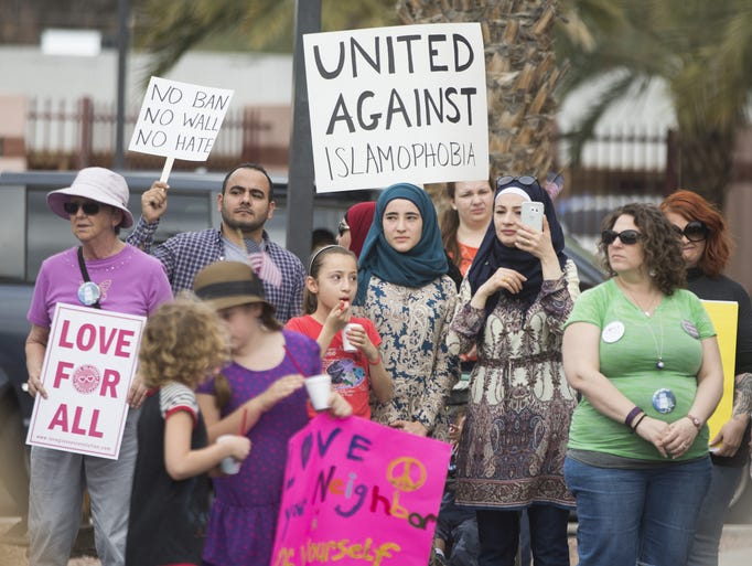 People of all faiths gather during a rally of solidarity