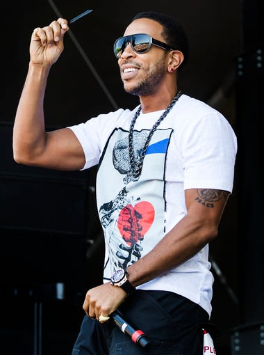 Ludacris performs on the Lawn Stage at the Firefly Music Festival in Dover on Sunday.