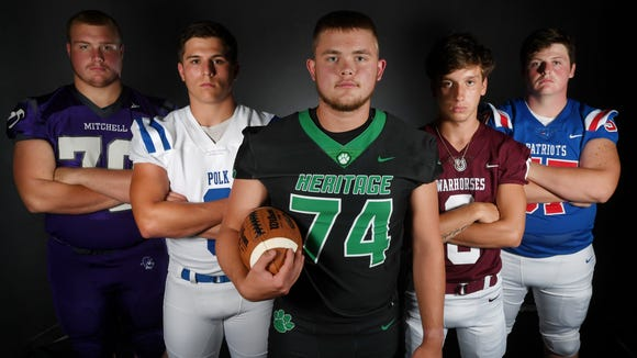 Football players in the Western Highlands Conference, from left, Mitchell's Hudson Boone, Polk County's Bryson Seay, Mountain Heritage's Zeb Virnelson, Owen's Audun Meyers and Madison's Colby Arnett.
