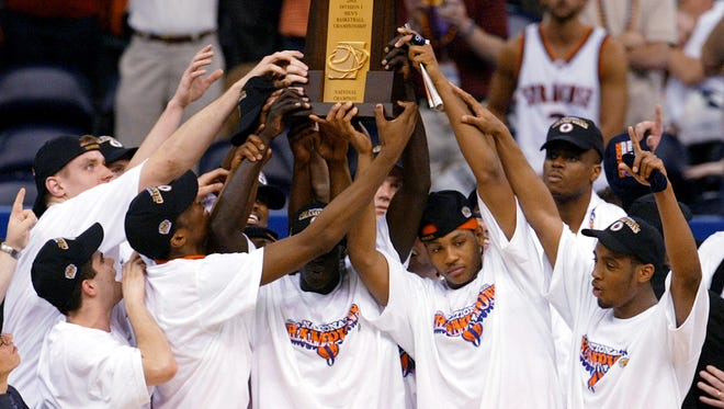 Syracuse players hold up their trophy after winning the national championship over against Kansas on April 7, 2003.