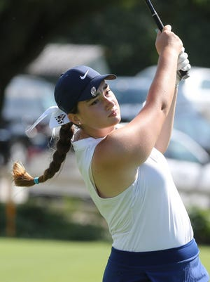 Louisville's Madison Gruber watches her shot on the 10th tee during last year's Marlington's Tri-County Invitational.