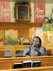 The Rev. Louise Jackson sits in Greater Mitchell Chapel AME Church which will be celebrating it's 150th anniversary Sunday.
