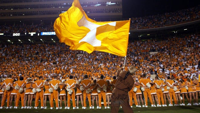 FILE - The cheerleaders, mascot and fans sing Rocky Top after defeating Florida at Neyland Stadium in Knoxville.