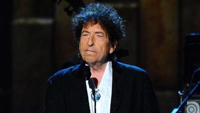 In this Feb. 6, 2015, file photo, Bob Dylan accepts the 2015 MusiCares Person of the Year award at the 2015 MusiCares Person of the Year show in Los Angeles. A handwritten ode to Wisconsin, written when Dylan was 20, is up for auction in Los Angeles. Bidding closes Thursday, March 30, 2017.