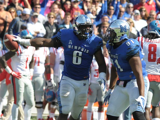 Memphis Tigers linebacker Genard Avery (6) and Memphis Tigers defensive lineman Ricky Hunter (91) celebrate during the game against Ole Miss in 2015.