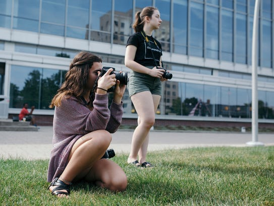 Students practice their photography skills during a