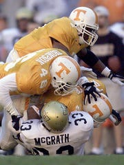 Vanderbilt running back Jared McGrath (33) is stopped
