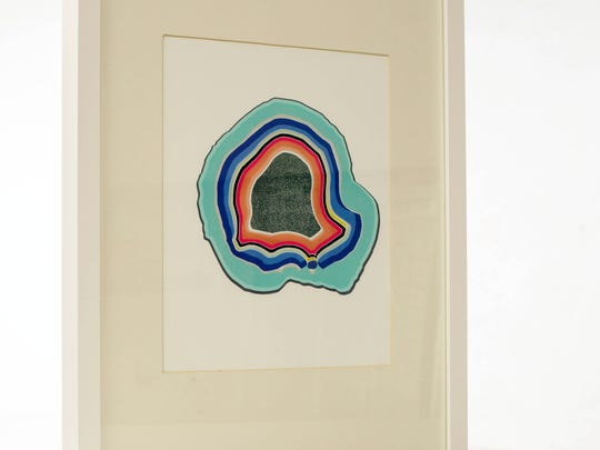 Playful Art: Prints and photos bring life to your walls, whether it be a full gallery wall or just a few. Mix and match different sized frames with clean, spring colors. A white frame with cream matte gives this print a gallery feel. Frame: Ikea, $7. Geode Print: Domestica, $30.