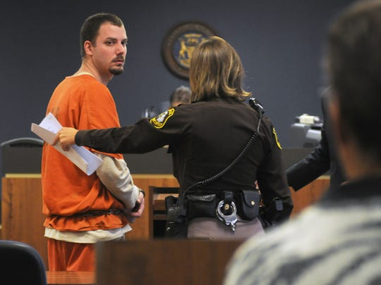 James Donald VanCallis looks back towards his family members Monday, Oct. 20 during his plea hearing for drug charges.