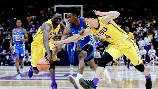 LSU forward Duop Reath (1) and guard Skylar Mays (4) knock the ball away from Kentucky guard Hamidou Diallo (3) during the first half at the Pete Maravich Assembly Center.