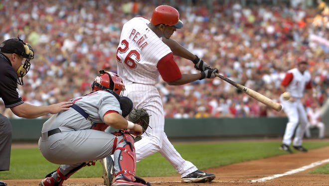 The Reds' Wily Mo Pena hits a home run against the Cardinals in July of 2004.