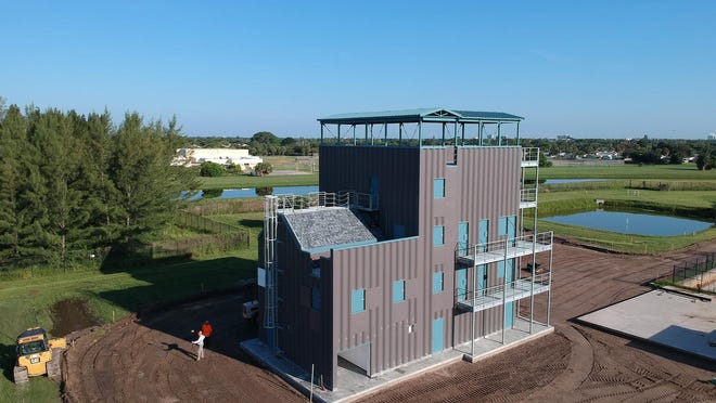 A four-story, metal tower that will serve as a training site for fire rescue personnel has been installed at the new $2.46 million public safety training complex on Richard Road in Palm Beach Gardens. The complex is expected to open next month.
