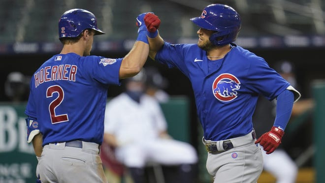 Chicago Cubs' David Bote celebrates his solo home run with Nico Hoerner (2) in the fourth inning against the Detroit Tigers in Detroit on Monday.