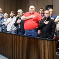 Mentors and veterans being helped by  Veterans Court recite the pledge of allegiance Friday November 20, 2015 at the Sheboygan County Courthouse in Sheboygan.