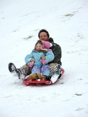 Sledding is a popular winter activity at Holmdel Park.