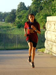 13-year old Yasmine Mansi, was the first finisher of