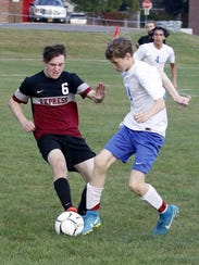 Robert McCarrick (6) of Elmira battles for possession