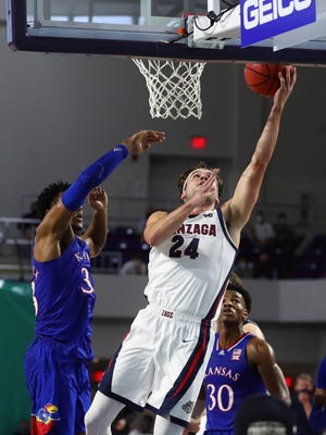 Gonzaga forward Corey Kispert shoots around Kansas forward David McCormack, left, during the first half of Thursday's game at Suncoast Credit Union Arena in Fort Myers, Fla. The top-ranked Bulldogs finished with 62 points in the paint in their 102-90 victory over the No. 6 Jayhawks.