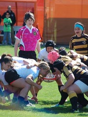 Indiana University's women's rugby team battles against American International College during the national quarterfinals of the USA Rugby Women's Collegiate Spring Championship. The team heads to Palm Coast, Fla. Saturday for the semifinals of the fall tournament.