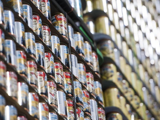 Cans of Great Falls Select and Beltian White are stacked