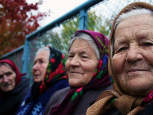 babushkas-group-in-front-of-fence.jpg