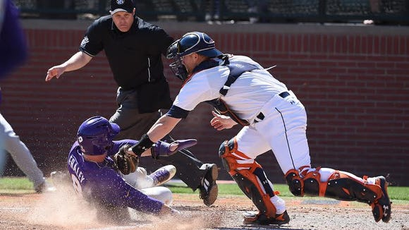 Auburn catcher Blake Logan applies a tag on a outfield