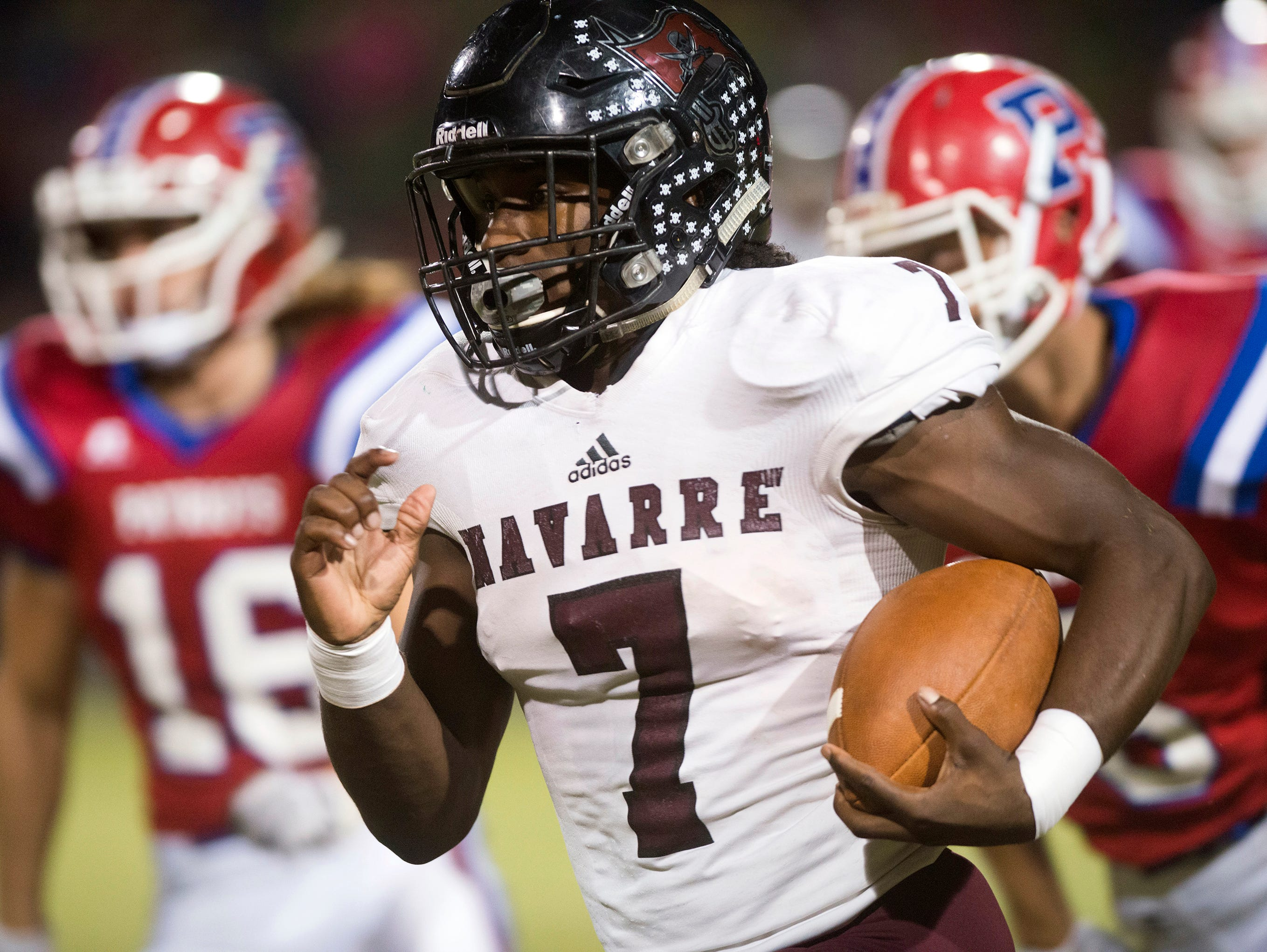 Navarre High School star running back Michael Carter (No. 7) runs for extra yards against the Pace High School defense during Friday night's District 2-6A matchup.
