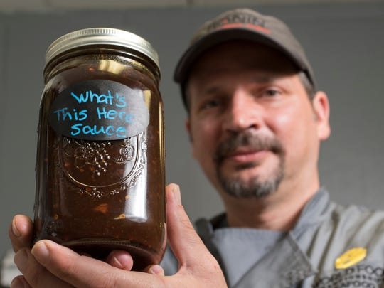 "Chef Chris Kelly shows off a jar of his homemade ""What's"