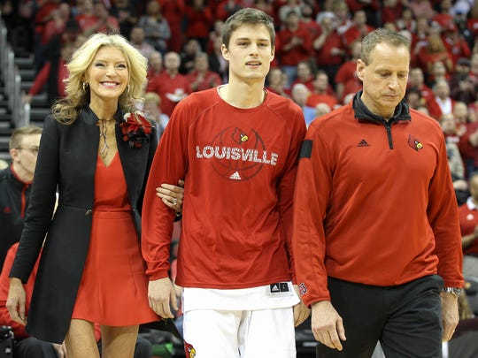 David Levitch arrives on the court with his family for senior day.March 4, 2017