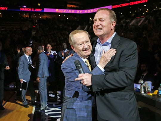 Suns owner Robert Sarver (right) embraces broadcaster