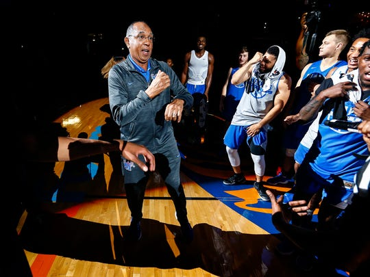 Tiger coach Tubby Smith (middle) dances with his players