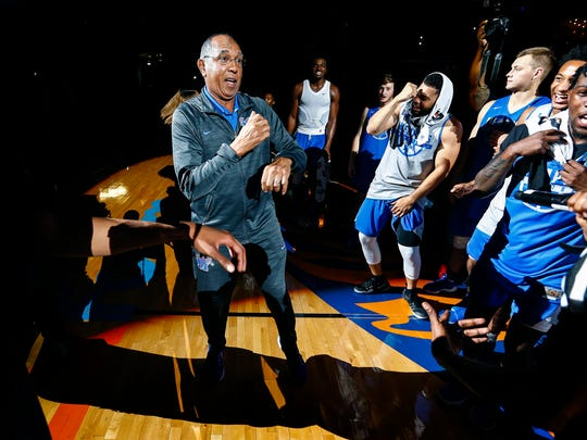 Tiger coach Tubby Smith (middle) dances with his players during Memphis Madness at the FedExForum Wednesday, Oct. 12, 2017.