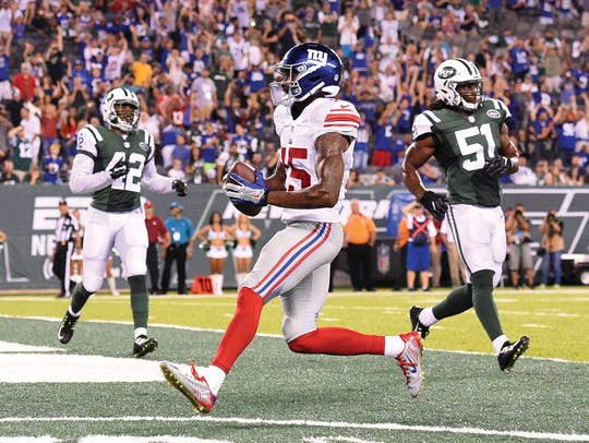 Tavarres King (No. 15) of the New York Giants runs