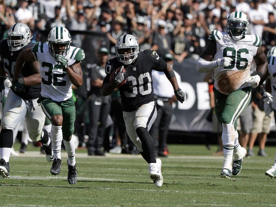 Oakland Raiders running back Jalen Richard (30) runs for a touchdown against the New York Jets during the second half of an NFL football game in Oakland, Calif., Sunday, Sept. 17, 2017. (AP Photo/Marcio Jose Sanchez)